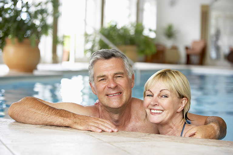 older couple in swimming pool